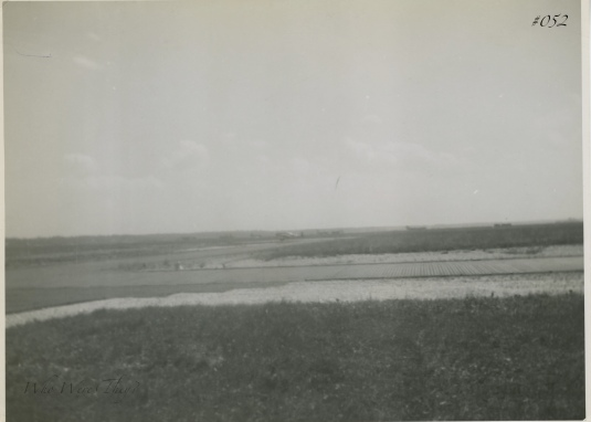 An airstrip, small plane in the distance